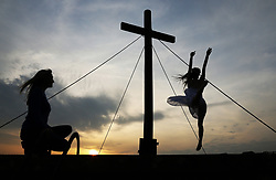 © Licensed to London News Pictures. 19/04/2019. Dancers take part in Good Friday commemorations overlooking Glastonbury Tor in Somerset, UK. Photo credit: Jason Bryant/LNP