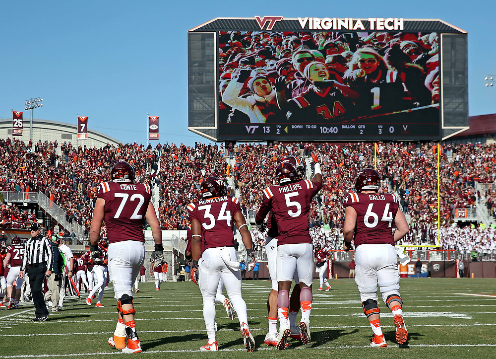 Nov 26, 2016; Blacksburg, VA, USA;  Virginia Tech Hokies wide receiver Cam Phillips (5) celebrates scoring a touchdown during the second quarter against the Virginia Cavaliers at Lane Stadium. Mandatory Credit: Peter Casey-USA TODAY Sports
