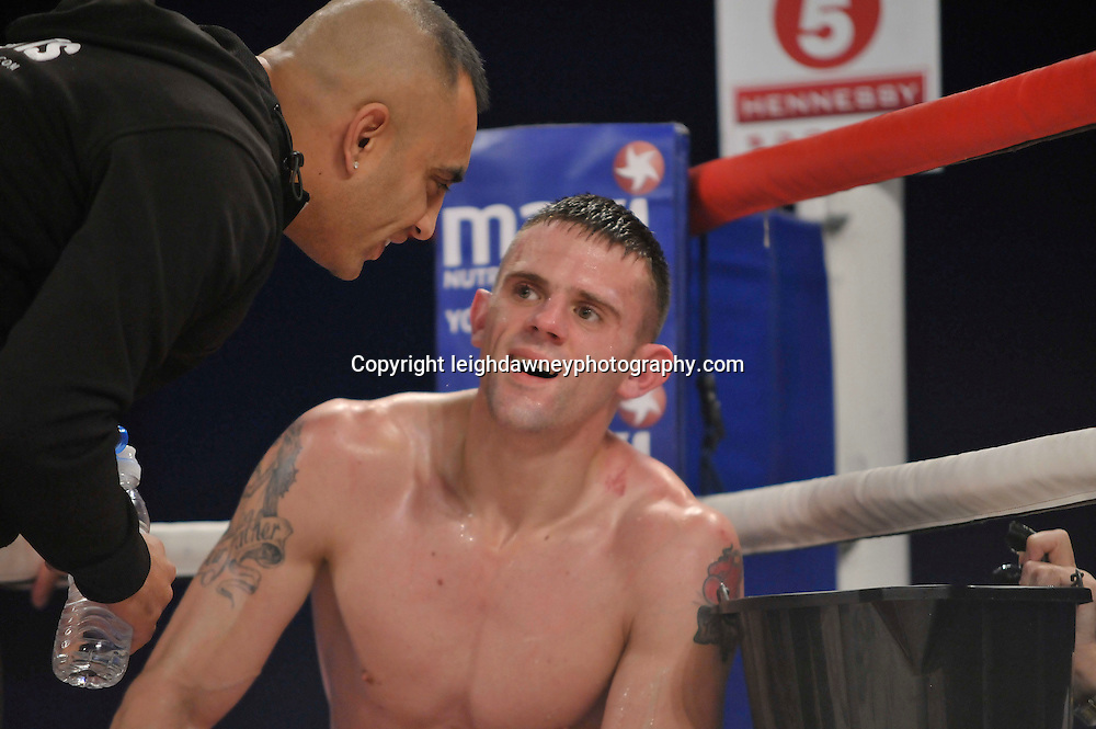 Martin Welsh defeats Tommy Broadbent (pictured with trainer) in a middleweight boxing contest at Glow, Bluewater, Kent on the 8th November 2014. Promoter: Hennessy Sports. © Leigh Dawney Photography 2014.