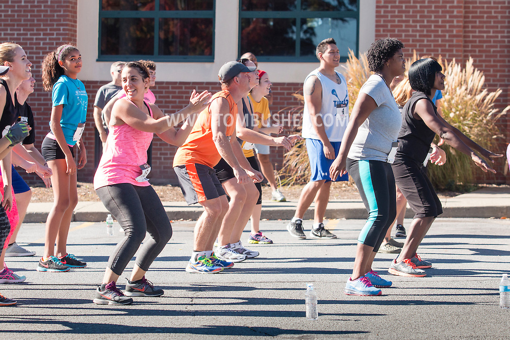 Middletown, New York  - Athletes compete in the Y Warrior obstacle course race at the YMCA of Middletown on Oct. 11, 2015.
