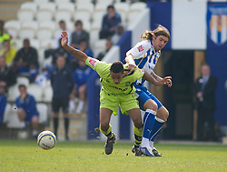 COLCHESTER, ENGLAND - Saturday, April 24, 2010: Tranmere Rovers' Shaleum Logan and Colchester United's Steven Gillespie in action during the Football League One match at the Western Community Stadium. (Photo by Gareth Davies/Propaganda)