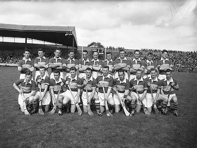 Neg No: .A801/4571-4583,..7091958AISHCF,..07.09.1958, 09.07.1958, 7th September 1958,..All Ireland Senior Hurling Championship - Final,..Tipperary.04-09,.Galway.02-05,..Tipperary Team,.Back row (from left) Noel Murphy, John McGrath, Mick Maher, Kieran Carey, Larry Keane, John Hough, Liam Devaney, John Doyle, Jimmy Finn, Mick Burns, Ray Reidy. Front Row (from left) Martin Maher, Liam Connolly, Jimmy Doyle, Tom Larkin, Theo English, Tony Wall (capt), John O'Grady, Mickey Byrne, Donie Nealon, Terry Moloney,