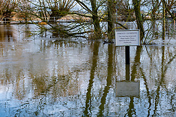 © Licensed to London News Pictures. 22/12/2019. Aylesbury, UK. A sign at the Old Fisherman pub in Shabbington in water after the River Thame burst its banks during heavy rain across Buckinghamshire. Photo credit: Peter Manning/LNP