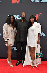 August 26, 2019, New York, New York, United States: Wyclef Jean (C) arriving at the 2019 MTV Video Music Awards at the Prudential Center on August 26, 2019 in Newark, New Jersey  (Credit Image: © Kristin Callahan/Ace Pictures via ZUMA Press)