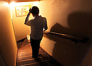 Ortrude White, who is the early stages of Alzheimer's, casts a dark shadow as walks down stairs to her office