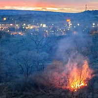 030114       Cable Hoover<br /> <br /> A brush fire flares up on the banks of the Rio Puerco near the Miyamura Overpass in Gallup as emergency crews try to gain access to the location Tuesday.