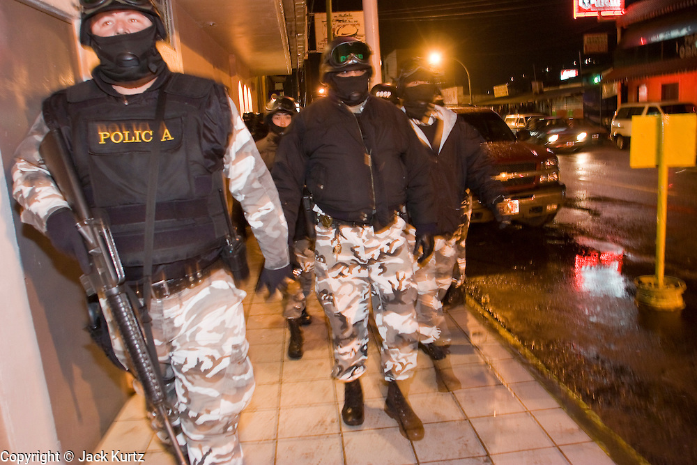 """05 FEBRUARY 2005 - NOGALES, SONORA, MEXICO: Members of """"Grupo Operativos"""" a special operations unit of the Nogales, Sonora, Mexico, police department, on patrol in Nogales, Saturday night, Feb. 5. The Operativos specialize in anti-gang enforcement and drug interdiction missions. In recent months they have stepped up patrol activity in Nogales communities near the border. In January 2005, the US Department of State has issued a travel advisory advising US citizens to avoid travel along the US Mexican border because of increased violence, including the kidnapping of US citizens, in border communities. Most of the violence has been linked to the drug cartels, who are increasingly powerful in Mexico. The Operativos also patrol the districts of Nogales frequented by US tourists in an effort to prevent crime directed against US citizens.   PHOTO BY JACK KURTZ"""