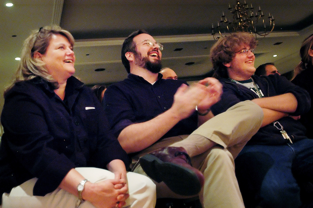 Mother Vickie Steiner, stepdad Jim Davenport and son and TiCom major Mike Steiner laugh at the antics of the Chicago Comedy show at the Baker Center Ballroom Nov. 5, 2005 on the Ohio University campus during Parent's Weekend.