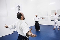 CASABLANCA, MOROCCO - 14 MAY 2016: (L-R) Brothers Ali (32) and Ahmed (28) Abdul Hakeem teach aikido to a class of students in the dojo their father Luqman founded after moving to Morocco in 1985, in Sidi Maarouf, a district of Casablanca, Morocco, on May 14th 2016.<br /> <br /> The Hakeem brothers are the sons of Luqman Abdul-Hakeem, a close follower of Malcolm X that chauffeured the African American activist around and introduced him to Cuban leader  Fidel Castro in September 1960.<br /> <br /> Born in Cleveland, OH, in 1934, Luqman Abdul-Hakeem was raised in Flushing, Queens, and then moved to Bayside, where he graduated in 1952. He attended the New York Technical University for a few months before enrolling in the Navy, where he stayed for two years. Though he had asked for ship duty, he ended up in Springfield, Mass., and Glennclose, Ill. He moved to Brooklyn when his hitch was done and by 1966 was studying jujitsu and aikido. He met Malcolm X during one of his sermons on 116th street in Harlem, New York, in the late 50's. In 1985, Mr. Hakeem decided to move to Marocco because America wasn't a country where he wanted to raise hois children. He has been teaching aikido in the two dojos he owns in Casablanca until 2014, when he underwent a surgery.