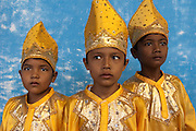Boys wearing traditional Minangkabau costumes pose for a photograph during a festival organized by children in Lubuk Basung, West Sumatra, Indonesia.