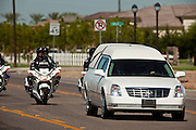 04 AUGUST 2010 -- GILBERT, AZ: The motorcade bearing the body of Det. Carlos Ledesma approaches Mission Community Church in Gilbert at the funeral for Chandler police detective Carlos Ledesma Wednesday. Ledesma was killed during a shoot out with suspected drug dealers during an undercover operation in south Phoenix Wednesday July 28.   PHOTO BY JACK KURTZ