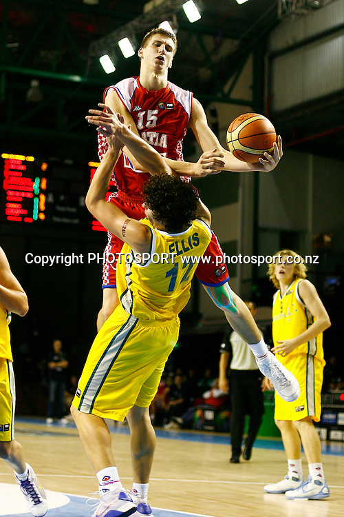Croatia's Tomislav Zubcic charges into Australia's Cody Ellis. U19 Basketball World Championship, 3rd and 4th place game, Australia v Croatia, North Shore Events Centre, Auckland. 12 July 2009. Photo: Anthony Au-Yeung/PHOTOSPORT