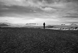 Woman watching towards the glaciers in Jokulsarlon, south east Iceland - Kona horfir til jökla við Jökulsárlón