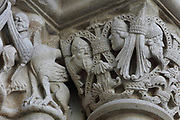 Carved capital with heads and leaves, from the South portal of the West facade, made 1135 and restored in 1839, at the Basilique Saint-Denis, Paris, France. Abbot Suger commissioned a relief of the martyrdom of St Denis on the tympanum of the portal, and was introducing a hagiography of St Denis with this imagery. The basilica is a large medieval 12th century Gothic abbey church and burial site of French kings from 10th - 18th centuries. Picture by Manuel Cohen
