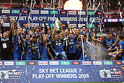 AFC Wimbledon defender Barry Fuller (2) lifts the trophy after winning the Sky Bet League 2 play off final match between AFC Wimbledon and Plymouth Argyle at Wembley Stadium, London, England on 30 May 2016.