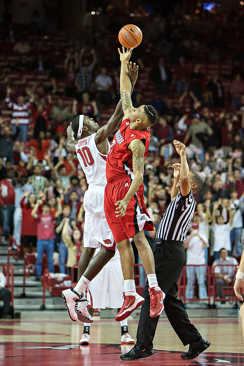 FAYETTEVILLE, AR - NOVEMBER 15:  Shawn Long #21 of the Louisiana Ragin' Cajuns goes up for the tip off against Bobby Portis #10 of the Arkansas Razorbacks at Bud Walton Arena on November 15, 2013 in Fayetteville, Arkansas.  The Razorbacks defeated the Ragin' Cajuns 76-63.  (Photo by Wesley Hitt/Getty Images) *** Local Caption *** Shawn Long; Bobby Portis