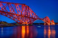 The Forth Bridge at twilight – a magnificent railway bridge.