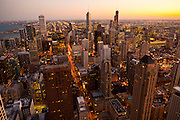 Sunset over the Chicago skyline looking south from the Hancock Tower along the lake front in Chicago, IL, USA.
