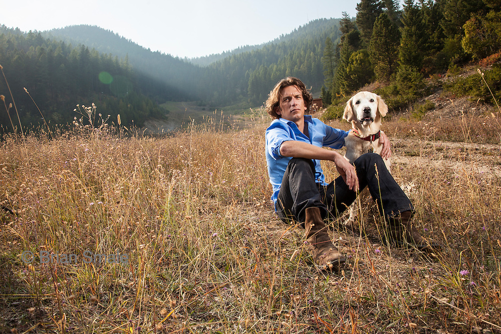 """Tyler Hamilton, former member of US Postal Service Cycling Team. Photographed with his dog """"Tanker"""" near Missoula, Montana by Brian Smale for the Sunday Times."""