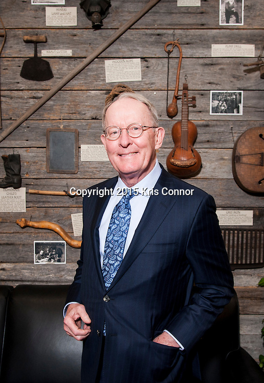 Senator Lamar Alexander(R-TN) poses in front of a display of Tennessee artifacts that line the walls of the lobby of his Washington DC senate office in the Dirksen Senate Office Building in Washington DC on December 7, 2015. Photo by Kris Connor