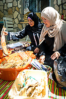 Using banana leaves, palm fronds, and straws, Alia and Um Hani teach us how to make traditional baskets.