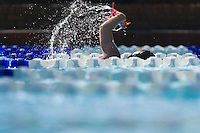 kids practice their technique by swimming laps in a competition pool with lanes