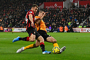 Conor Coady (16) of Wolverhampton Wanderers denies Ryan Fraser (24) of AFC Bournemouth a chance to score during the Premier League match between Bournemouth and Wolverhampton Wanderers at the Vitality Stadium, Bournemouth, England on 23 November 2019.