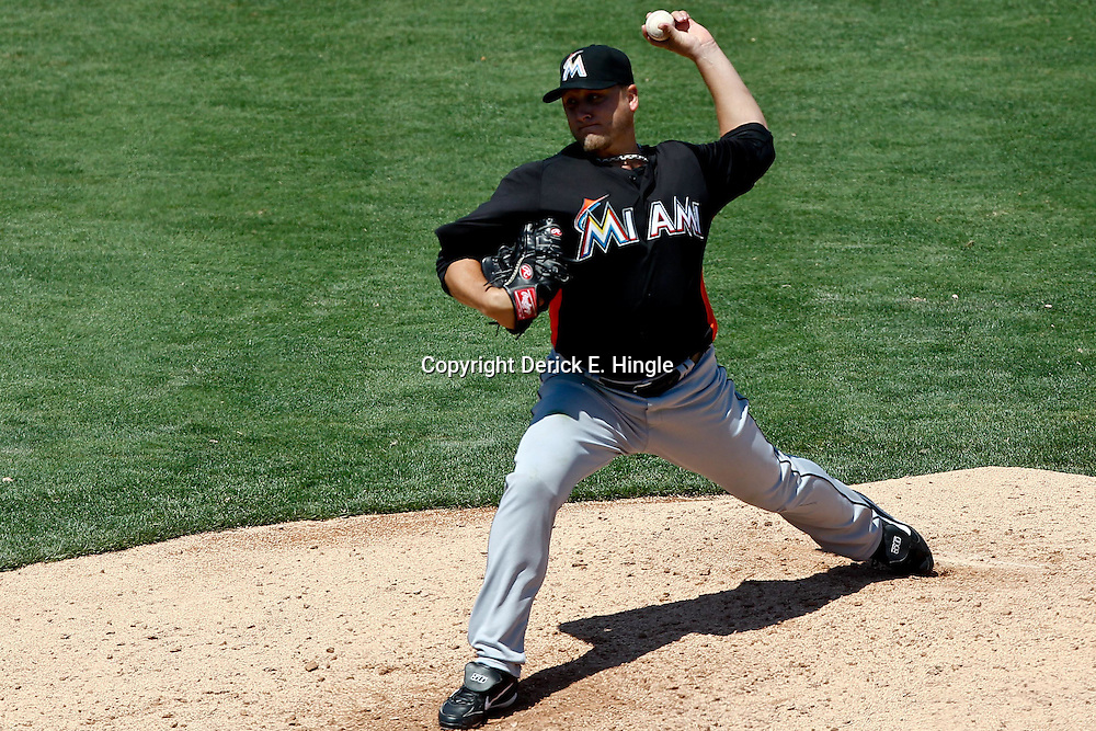 March 26, 2012; Lakeland, FL, USA; Miami Marlins starting pitcher Mark Buehrle (56) throws against the Detroit Tigers during the bottom of the sixth inning of a spring training game at Joker Marchant Stadium. Mandatory Credit: Derick E. Hingle-US PRESSWIRE