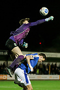 Rory Watson (on loan from Scunthorpe United) (North Ferriby United) jumps high over the Tranmere Rovers player but misses the ball during the Vanarama National League match between North Ferriby United and Tranmere Rovers at Eon Visual Media Stadium, North Ferriby, United Kingdom on 21 March 2017. Photo by Mark P Doherty.
