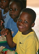 ORPHANS AT TEA TIME AT KONDANANI CHILDRENS ORPHANAGE IN BLANTYRE MALAWI SOUTH EASTERN AFRICA.23.11.06.PIX STEVE BUTLER