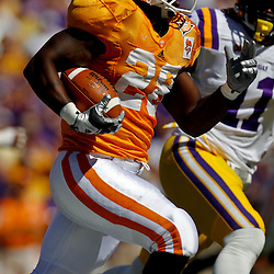 Oct 2, 2010; Baton Rouge, LA, USA; Tennessee Volunteers running back Tauren Poole (28) runs against the LSU Tigers during the first quarter at Tiger Stadium. LSU defeated Tennessee 16-14.  Mandatory Credit: Derick E. Hingle