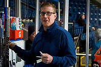 KELOWNA, CANADA - MARCH 13: Spokane Chiefs' equipment manager Tim Lindblade stands on the bench with gum as part of a pre-game ritual at the start of warm up against the Kelowna Rockets on March 13, 2019 at Prospera Place in Kelowna, British Columbia, Canada.  (Photo by Marissa Baecker/Shoot the Breeze)