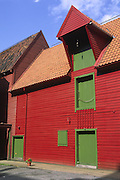 vibrant red & green building at Bryggen; a World Heritage Site; old architecture; Bergen; Norway