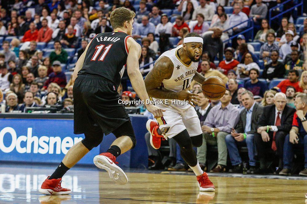 Mar 14, 2017; New Orleans, LA, USA; New Orleans Pelicans forward DeMarcus Cousins (0) drives past Portland Trail Blazers forward Meyers Leonard (11) during the first quarter of a game at the Smoothie King Center. Mandatory Credit: Derick E. Hingle-USA TODAY Sports