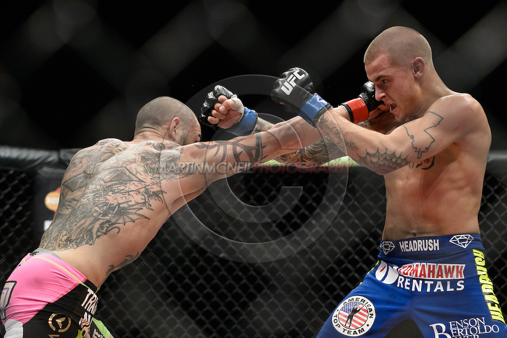 "LONDON, ENGLAND, FEBRUARY 16, 2013: Cub Swanson (L) narrowly misses Dustin Poirier during ""UFC on Fuel TV 7: Barao vs. McDonald"" inside Wembley Arena in Wembley, London on Saturday, February 16, 2013 (© Martin McNeil)"