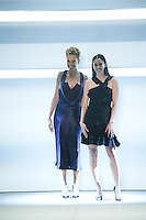 Carly Cuschnie and Michele Ochs greet the audience after presenting the Cushnie et Ochs Fall 2016 collection during New York Fashion Week on February 12, 2016