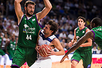 Real Madrid's player Sergio Llull and Unicaja Malaga's player Dejan Musli and Oliver Lafayette during match of Liga Endesa at Barclaycard Center in Madrid. September 30, Spain. 2016. (ALTERPHOTOS/BorjaB.Hojas)