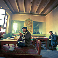 Uyghur men drink Tea inside of a tea house in Kashgar oldest city, Xinjiang, on February 21, 2010. Photographer: Bernardo De Niz
