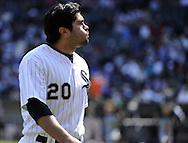 CHICAGO - JUNE 12:  Carlos Quentin #20 of the Chicago White Sox takes a deep breath while looking on against the Oakland Athletics on June 12, 2011 at U.S. Cellular Field in Chicago, Illinois.  The White Sox defeated the Athletics 5-4.  (Photo by Ron Vesely)   Subject:  Carlos Quentin