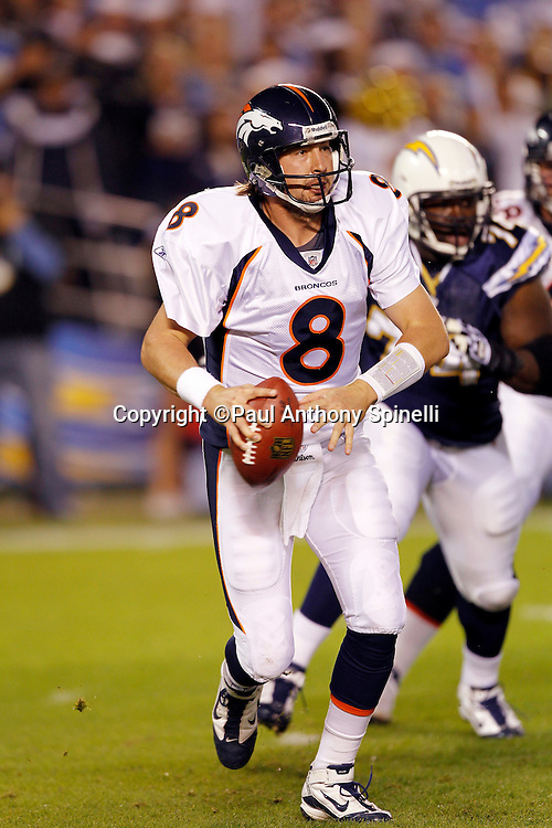 Denver Broncos quarterback Kyle Orton (8) gets chased out of the pocket during the NFL week 11 football game against the San Diego Chargers on Monday, November 22, 2010 in San Diego, California. The Chargers won the game 35-14. (©Paul Anthony Spinelli)