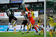 Dagenham & Redbridge's Mark Cousins deals with a dangerous ball in the box during the Sky Bet League 2 match between Plymouth Argyle and Dagenham and Redbridge at Home Park, Plymouth, England on 23 April 2016. Photo by Graham Hunt.