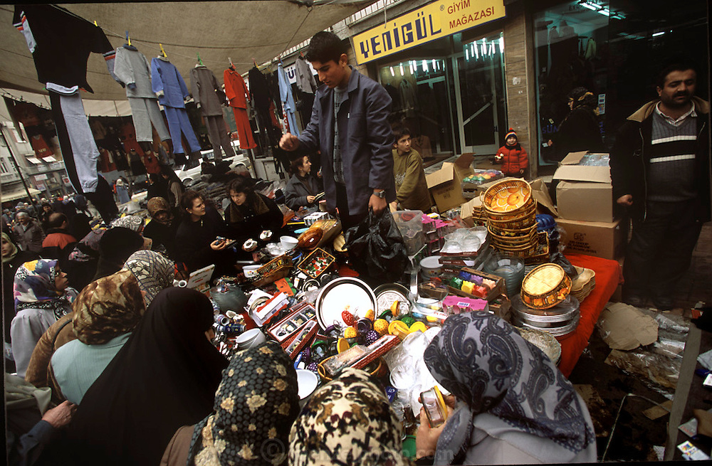 Turkish vendors move about Istanbul from one area of the city to another to sell their wares at the street markets that are held on different days. Some wares are more popular than others, as evidenced by this seller of cheap kitchen gadgets. (Supporting image from the project Hungry Planet: What the World Eats).