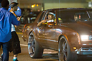 """Police and protesters clash in the streets of Ferguson. Heavily armed police provoked many of the protesters as they swooped in, guns pointing, to  arrest deemed """"troublemakers"""" among the protesters in downtown Ferguson following the killing of unarmed Michael Brown (18)."""