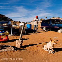 031108     Brian Leddy.Chuey, a chihuahua mix, sits by as his owner Mark Sands fixes an axe handle at their home in Iyanbito on Tuesday afternoon. Sands said he had about a month left of gathering wood in the mountains near his home before it would be warm enough to not have to heat the house.