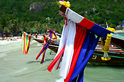 long tailed boat Koh Phangan Thailand with thai flag on the bow