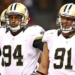 August 17, 2012; New Orleans, LA, USA; New Orleans Saints defensive end Cameron Jordan (94) and defensive end Will Smith (91) during the first half of a preseason game against the Jacksonville Jaguars at the Mercedes-Benz Superdome. Mandatory Credit: Derick E. Hingle-US PRESSWIRE