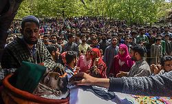 April 25, 2018 - Handura, Kashmir, India - Kashmiri Muslims gather around the body of Ishfaq Ahmed Khan, a local rebel commander killed in a gun battle with Indian armed forces, during his funeral on April 25, 2018 in  Handura,  50 km (31 miles) south of Srinagar, the summer capital of Indian administered Kashmir, India. Thousands of Kashmiris attended the funeral of two rebels killed yesterday in a gun battle, by the Indian government forces. Six people were killed on Tuesday in a gun battle between Indian armed forces and rebels in the forest area of Tral, in south Kashmirs Pulwama district. Indian government forces killed four rebels including two Pakistan militants, in a 12-hour-long gun battle in Lam forests of Tral area yesterday in south Kashmirs Pulwama district. An Indian army trooper and an Indian policeman were also killed in the exchange of fire between Indian armed forces and militants who were hiding in the forest are. Clashes erupted in Aripal area of Tral after youth took to streets and hurled rocks at the Indian armed forces deployed there. (Photo by Kabli Yawar / NurPhoto) (Credit Image: © Yawar Nazir/NurPhoto via ZUMA Press)