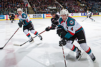 KELOWNA, CANADA - MARCH 10: Erik Gardiner #12 and Gordie Ballhorn #4 of the Kelowna Rockets move the puck across centre with Calvin Spencer #22 of the Vancouver Giants in pursuit on March 10, 2017 at Prospera Place in Kelowna, British Columbia, Canada.  (Photo by Marissa Baecker/Shoot the Breeze)  *** Local Caption ***
