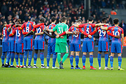 Crystal Palace players during a minute's silence for all of the Crystal Palace fans that sadly passed away in 2018 during the Premier League match between Crystal Palace and Chelsea at Selhurst Park, London, England on 30 December 2018.