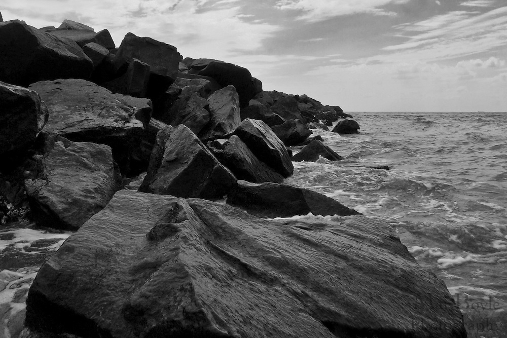 Waves hit a rock jetty  during a summer afternoon at Sunset Beach, Cape May New Jersey.